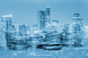 Double exposure of coins and city for business finance concept.