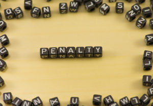 The word penalty on wood background